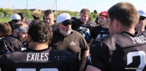 Head Coach John Moore rallies his troops post win